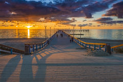 Sunrise at the Baltic sea, Palanga. Sunrise at the famous marine pier in resort city of Palanga, Lithuania, Europe Royalty Free Stock Images