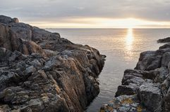 Sunrise on the Baltic sea. Sunlit rocks at dawn in Stockholm archipelago Royalty Free Stock Image