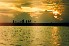 Sunrise at Bantayan Islands. People in silhouette enjoying sunrise at Bantayan Islands, Philippines Stock Photography