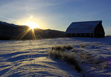 Barn in Winter at Sunrise with Snow Stock Photo