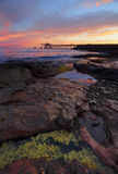 Sunrise from Bass Point with Gravel Loader pier in distance Stock Photo