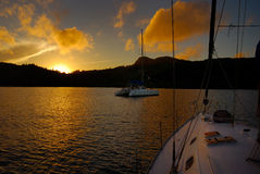 Sunrise in the bay. On Anchor in Anse a la Mouche, Mahe, Seychelles stock images