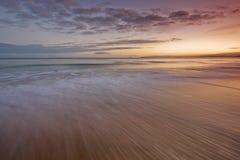 Sunrise on beach Stock Photo