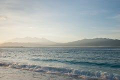 Sunrise on the beach. Sunrise in Gili Trawangan, Indonesia. In the background Mount Rinjani in Lombok Stock Image