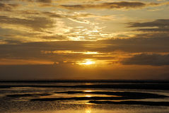 The sunrise on the beach. The scene of sunrise on the beach Royalty Free Stock Photos