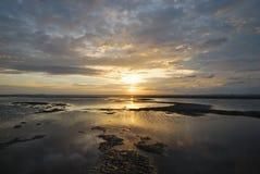 The sunrise on the beach. The scene of sunrise on the beach Royalty Free Stock Image