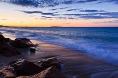 Sunrise beach. A beautiful sunrise on a wild beach Stock Photo