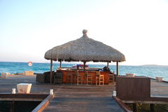 Sunrise on the beach. By beach umbrellas and lounge Stock Photos