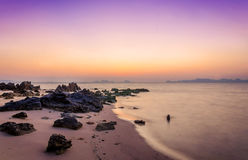 Sunrise on the beach of andaman sea Stock Photos
