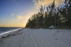 Sunrise beach Stock Images