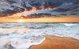 Sunrise on the beach. Atmosphere at sunrise on the beach Royalty Free Stock Image