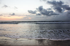 SUNRISE ON THE BEACH  BALI Stock Photos