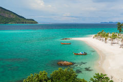 Sunrise beach with blue cloud sky in Koh Lipe island. Stock Image