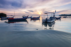 Sunrise by the beach with boat in George Town, Penang Malaysia. Beautiful landscape series of sunrise and sunset collection from George Town, Penang, Malaysia Royalty Free Stock Photos