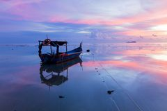 Sunrise by the beach with boat in George Town, Penang Malaysia. Beautiful landscape series of sunrise and sunset collection from George Town, Penang, Malaysia Royalty Free Stock Images