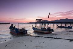 Sunrise by the beach with boat in George Town, Penang Malaysia. Beautiful landscape series of sunrise and sunset collection from George Town, Penang, Malaysia Stock Images
