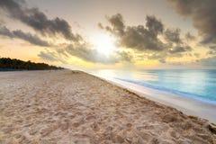 Sunrise on the beach of Caribbean sea. Mexico Stock Photos