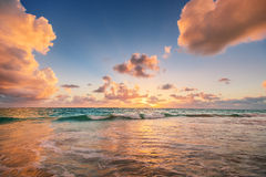 Sunrise on the beach of Caribbean sea Stock Image