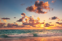 Sunrise on the beach of Caribbean sea Royalty Free Stock Images