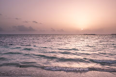 Sunrise on a beach Stock Images