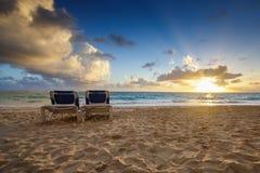 Sunrise, beach chairs on the tropical carribean beach Stock Images