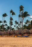Sunrise, beach chairs on the tropical carribean beach Royalty Free Stock Image