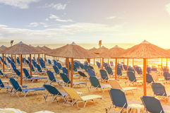 Sunrise and beach club sunbed earl in the morning. Close Stock Image