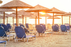 Sunrise and beach club sunbed earl in the morning. Close Royalty Free Stock Images