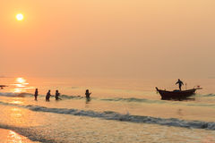 Sunrise Beach. And fisherman, fishing boat Stock Photos