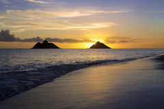 Sunrise on the beach in hawaii. Sunrise at lanikai beach in hawaii with the mokulua islands Royalty Free Stock Photography