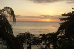 Sunrise on a beach hotel Stock Photos