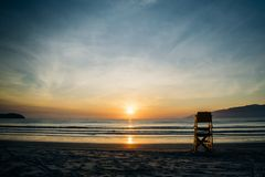 Sunrise on the beach with lifeguard stand royalty free stock photo