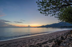 Sunrise at the beach in indonesia. At vacation stock photography