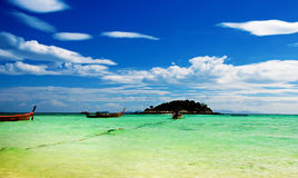 Sunrise beach in Koh Lipe. Longtail boats on Sunrise beach in Koh Lipe, Thailand Royalty Free Stock Image
