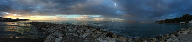 Sunrise on the beach, Malaga, Andalusia, Spain. Pedregalego, Este Malaga, a former small fishing village nowadays seaside resort (panoramic view Stock Images