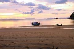 Sunrise and beach Stock Photos