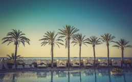 Sunrise at a beach resort Royalty Free Stock Image
