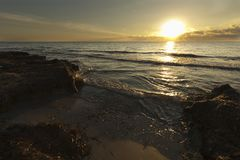 Sunrise on a beach in Santa Pola. Alicante province, Spain Stock Images