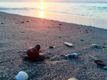 Sunrise on a beach with small stones Stock Photo