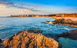 Sunrise at the beach of Sozopol. SOZOPOL, BULGARIA - SEPTEMBER 9, 2013: sunrise on sandy city beach in mellow season. Beautiful and warm weather on the shores of royalty free stock photos