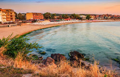 Sunrise at the beach of Sozopol. SOZOPOL, BULGARIA - SEPTEMBER 11, 2013: sunrise on sandy city beach in mellow season. Beautiful and warm weather on the shores stock photo