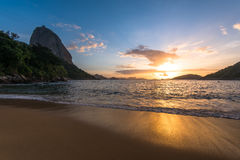 Sunrise in the Beach with the Sugarloaf Mountain Royalty Free Stock Photo