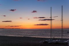 Sunrise on the beach with two catamarans stranded on the shore in Mojacar Almeria. Spain stock photos