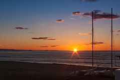 Sunrise on the beach with two catamarans stranded on the shore in Mojacar Almeria. Spain royalty free stock image