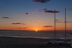 Sunrise on the beach with two catamarans stranded on the shore in Mojacar Almeria. Spain royalty free stock photography