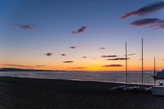 Sunrise on the beach with two catamarans stranded on the shore in Mojacar Almeria. Spain royalty free stock photos