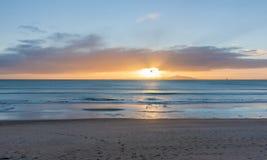 Sunrise on beach Waipu Cove Royalty Free Stock Photography