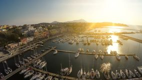 Sunrise beams penetrating Italian town with nice architecture and luxury marina. Stock footage stock footage