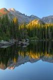 Sunrise on Bear Lake in Rocky Mountain National Park. Sunrise on Long's Peak and the stillness of Bear Lake at Rocky Mountain National park in Estes park stock image