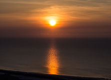 Sunrise with beautiful colors at the sea. And coast Royalty Free Stock Photo